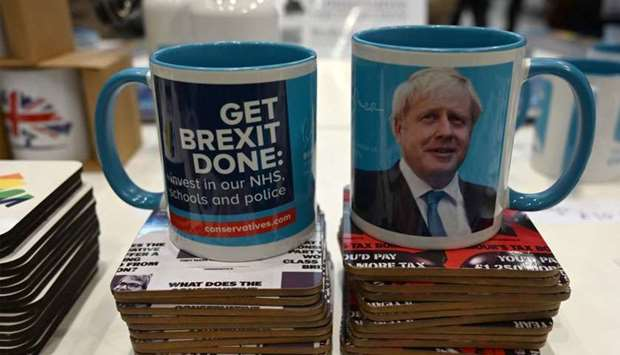 Mugs and coasters are seen for sale in support of Brexit and the Conservative leader