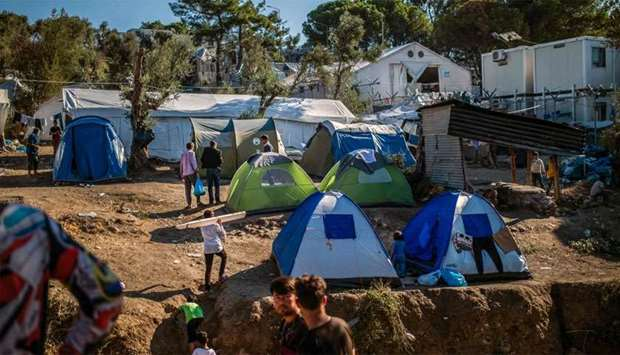 Refugees and migrants gather at Moria camp on the island of Lesbos