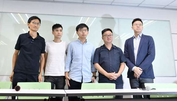 Pro-democracy activists Eddie Chu, Lester Shum, Joshua Wong, Democratic Progressive Party (DPP) Secr