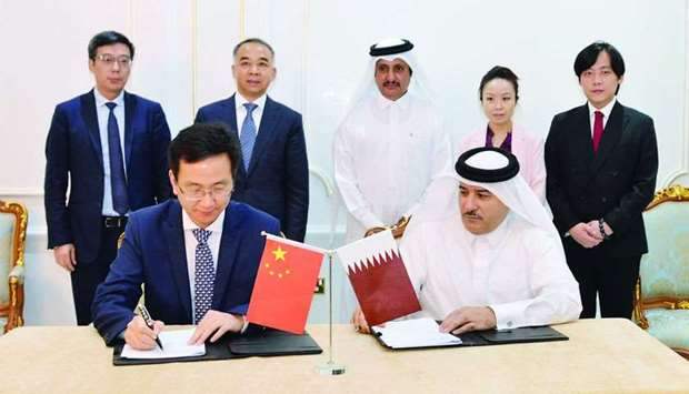 Sheikh Khalifa and Ruiping witness the signing ceremony between Taleb Group chairman Mohamed Taleb a