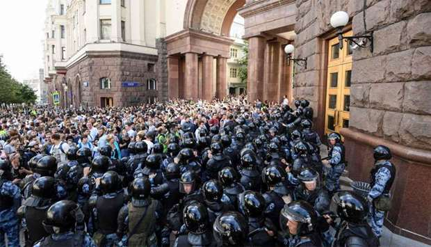 Protesters confront riot police in downtown Moscow