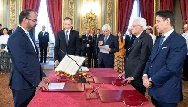 New Italian government is sworn in at the presidential palace in Rome