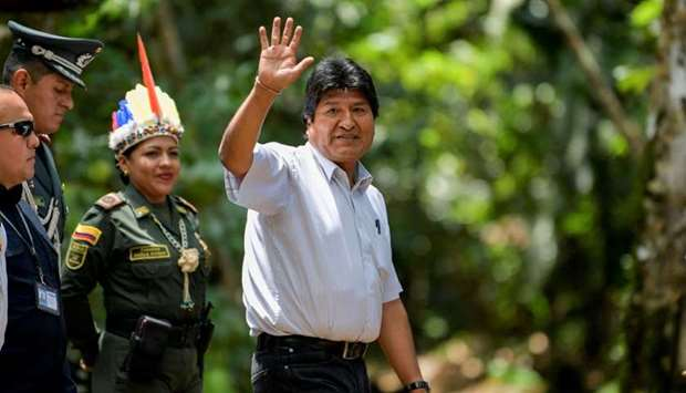 Bolivia's President Evo Morales waves as he arrives for the Presidential Summit for the Amazon at th