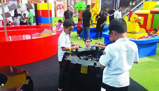 Young visitors try to assemble different objects at the Lego Technic+Architecture zone. PICTURES: Jo