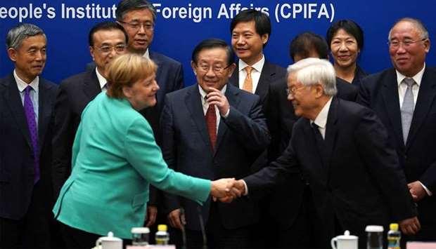 Caught between human rights and trade, Angela Merkel lands in China
