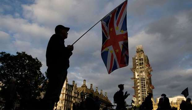 A composite Union and EU flag is seen on Parliament Square outside the Houses of Parliament in centr