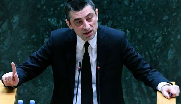 New Georgian Prime Minister Giorgi Gakharia speaks at the Parliament in Tbilisi as he faces a confid