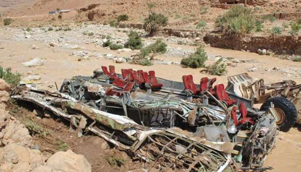 The wreckage of a bus, following a flood-related accident at the Damchan river near the city of Erra