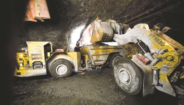A front end loader dumps a bucket full of copper and nickel ore into a 40-tonne truck at a mine in S