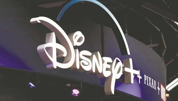 Signage for the Disney+ streaming service is displayed during the D23 Expo 2019 in Anaheim, Californ