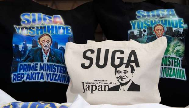 Merchandise featuring Japan's expected new prime minister Yoshihide Suga are displayed at designer I