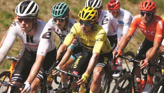 Team Jumbo-Visma rider Primoz Roglic of Slovenia, wearing the overall leader's yellow jersey, in act