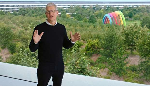 Apple CEO Tim Cook speaks during a special event at the company's headquarters of Apple Park in a st