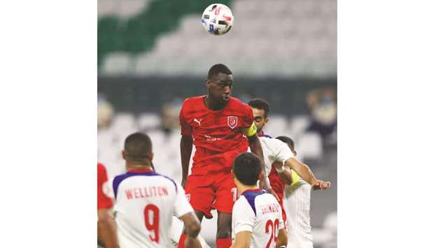 Al Duhail's Almoez Ali (centre) in action during the AFC Champions League Group C match against Shar
