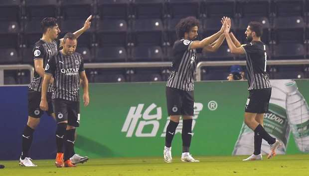 Al Sadd's Akram Afif (second from right) is congratulated by teammates Baghdad Bounedjah (left), San
