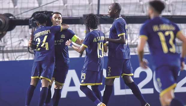 Al Nassr's Abderazak Hamdallah (second from left) celebrates his goal with teammates during the AFC