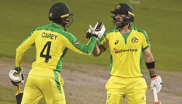 Australia's Glenn Maxwell (right) celebrates his century with Alex Carey during the third ODI agains