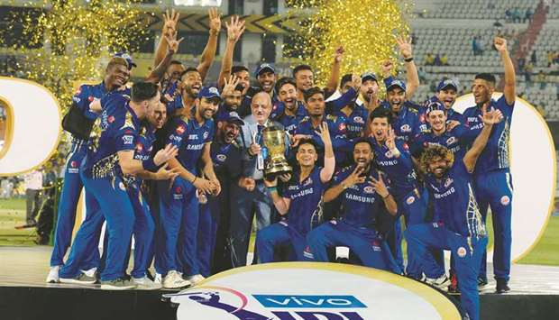 The victorious Mumbai Indians team with the IPL trophy after winning the tournament in 2019.