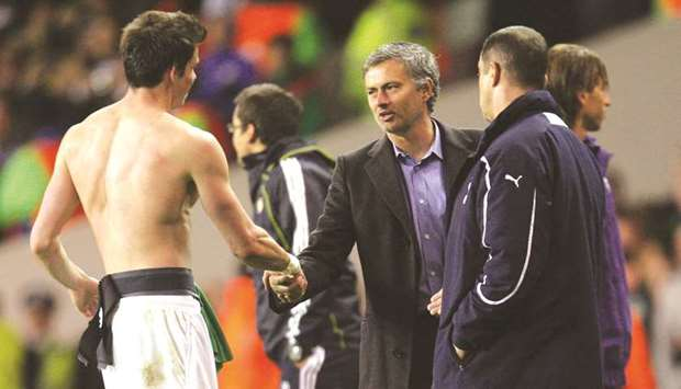 In this April 13, 2011, picture, the then Real Madrid coach Jose Mourinho (centre) shakes hands with