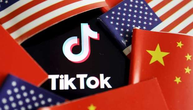 China and U.S. flags are seen near a TikTok logo in this illustration picture taken July 16, 2020