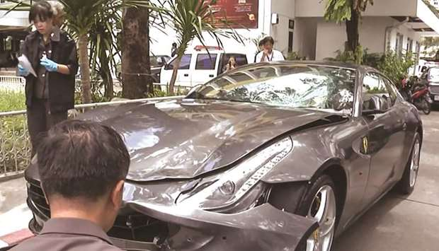 In this file photo frame grab from video footage shows police inspecting the Ferrari car belonging t