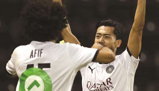 Rodrigo Tabata (right), who is two months shy of his 40th birthday, scored Al Sadd's fourth goal in