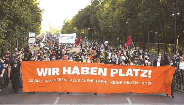 Protesters hold a banner reading 'We have the space' during a demonstration in Berlin for the evacua