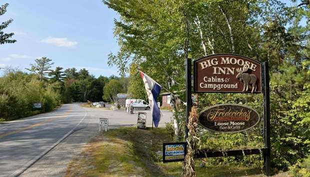 The entrance sign for the Big Moose Inn, Cabins, & Campground where a wedding, connected to seven de