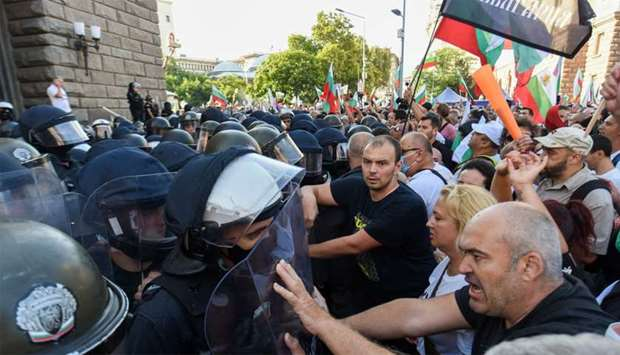 Protesters clash with police officers during an anti-government demo in Sofia
