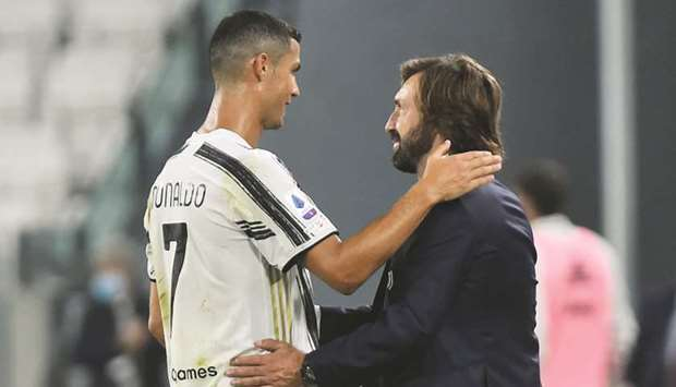 Juventus' Cristiano Ronaldo and coach Andrea Pirlo celebrate their win over Sampdoria in Turin. (Reu