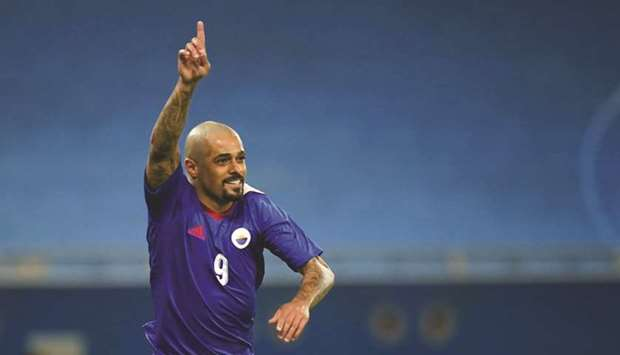 Sharjah's Welliton celebrates a goal during the AFC Champions League Group C match against Al Taawou