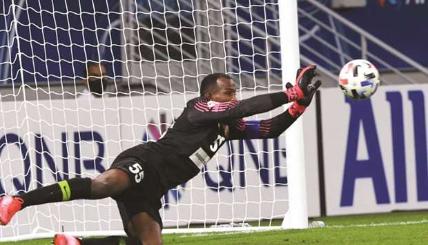 Shabab Al Ahli goalkeeper Majed Nasser in action during the AFC Champions League match against Pakht