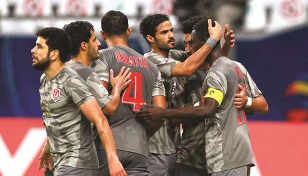 Al Duhail's Almoez Ali (right) celebrates after scoring the winner during the AFC Champions League G