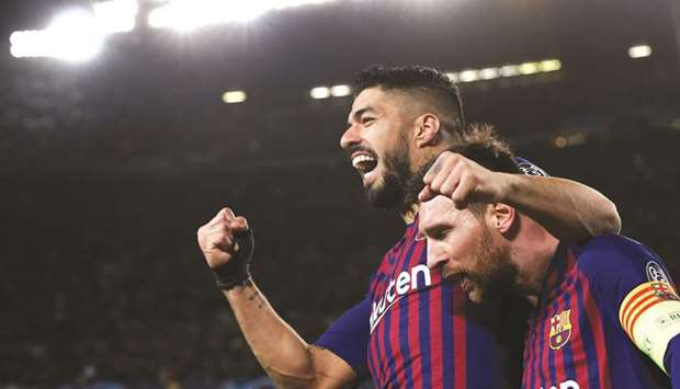 In this file photo taken on March 13, 2019, Barcelona's Argentinian forward Lionel Messi (right) cel