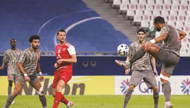 Duhail's Medhi Benatia (right) clears the ball during the AFC Champions League Group C match against