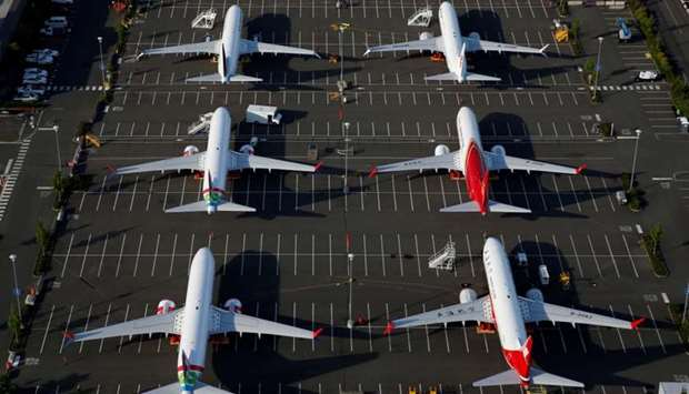 Boeing 737 Max aircraft are parked in a parking lot at Boeing Field in this aerial photo taken over