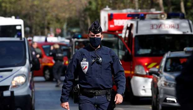 A police officer is seen at the scene of an incident near the former offices of French magazine Char