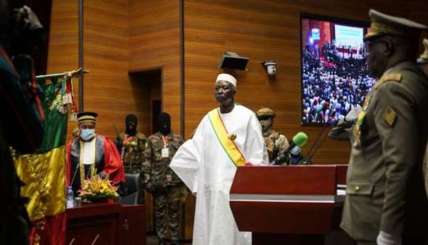 Transition Mali President Bah Ndaw (C) is seen during his inauguration ceremony at the CICB (Centre