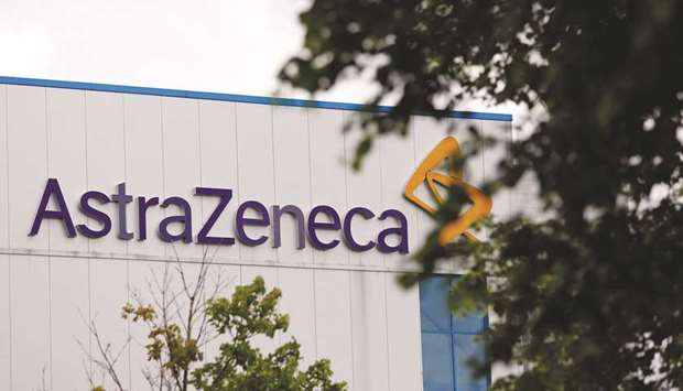 An AstraZeneca sign sits outside the company's factory in Macclesfield, UK. AstraZeneca has secured