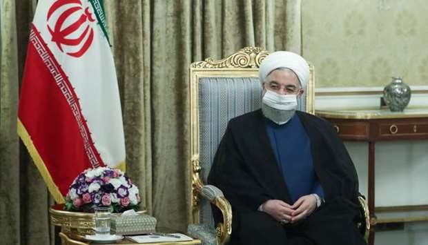 President Hassan Rouhani during his meeting with Iraqi Foreign Minister Fouad Hussein (unseen) in th