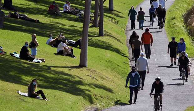 People exercise at a park along the Yarra River in Melbourne as an overnight curfew in Australia's s
