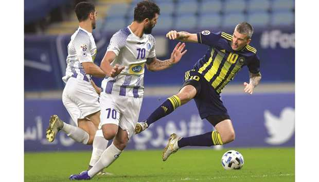 Pakhtakor's Dragan Ceran (right) in action during the AFC Chaampions League Round of 16 tie against