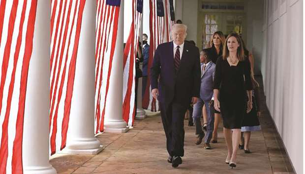 US President Donald Trump and judge Amy Coney Barrett arrive at the Rose Garden of the White House i