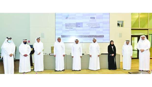 QU and CCQ officials at the MoU signing ceremony
