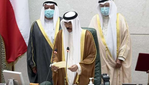 Kuwait's new Amir HH Sheikh Nawaf al-Ahmad al-Sabah holds a paper as he takes the oath of office at