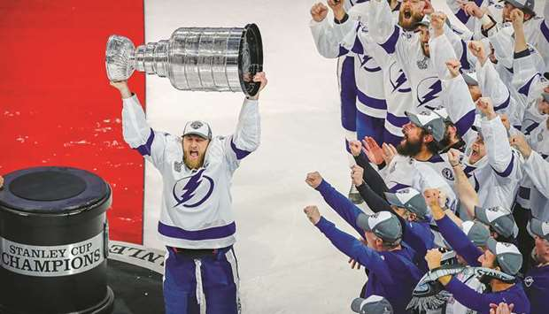 Tampa Bay Lightning center Steven Stamkos hoists the Stanley Cup after the Lightning defeated the Da