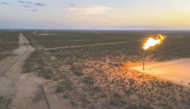 A gas flare burns at dusk in the Permian Basin in Texas (file). Investors managing more than $2tn ar