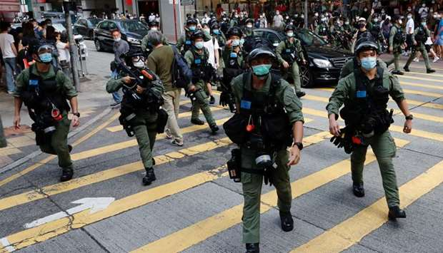 Riot police disperse pro-democracy protesters during a demonstration opposing postponed elections, i