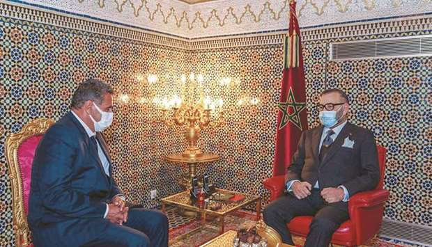 This handout picture released by the Moroccan Royal Palace shows King Mohamed VI receiving the head