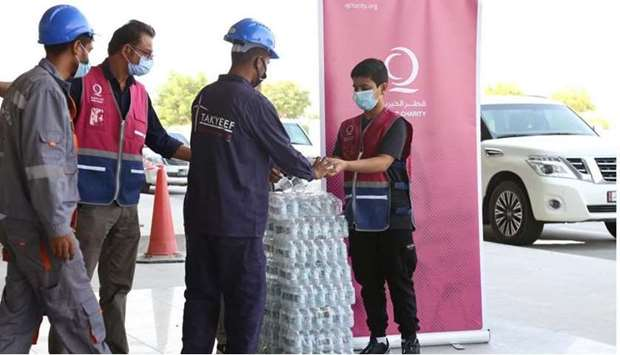 Qatar Charity joins hands with local initiative to distribute water to workers